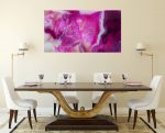 interior dining room setting with pink abstract wall art on wall dining table and four cream chairs