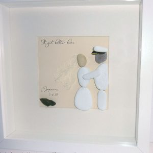 wedding pebble art bride in white dress and veil groom in sailers outfit with hat jamaica shaped stone at bottom