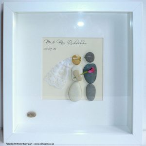 wedding pebble art bride with veil and a rose both bride and groom wearing tiny glasses